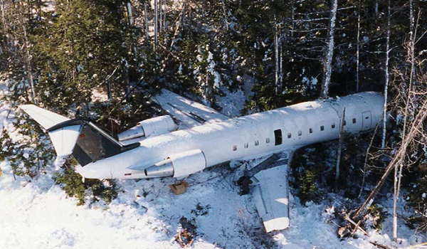Still of aircraft in the woods, from the landing accidents and runway overruns video